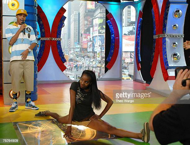 Chris Brown watches TRL audience members dance moves