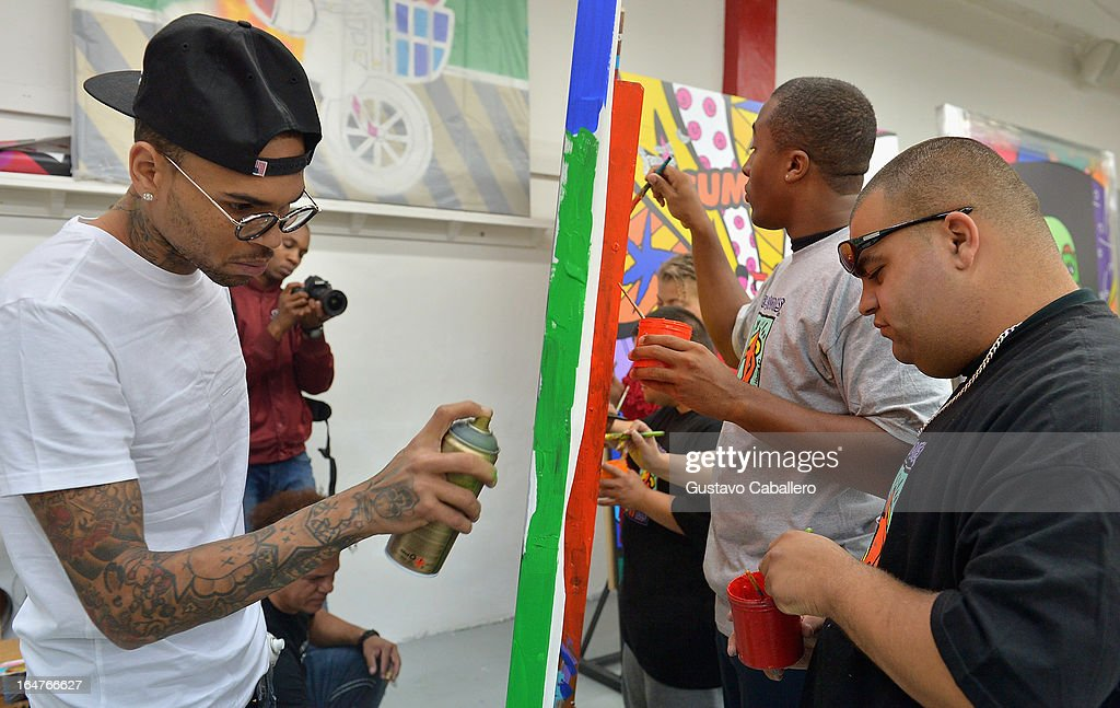 Chris Brown,Marcus Gray and Gino Carfagna attend the Chris Brown joins forces with artist Romero Britto in support of Best Buddies International event on March 27, 2013 in Miami, Florida.