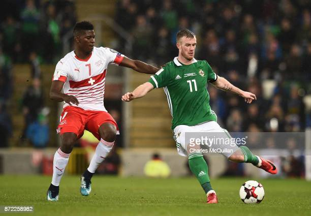 Chris Brunt of Northern Ireland and Breel Embolo of Switzerland during the FIFA 2018 World Cup Qualifier PlayOff first leg between Northern Ireland...