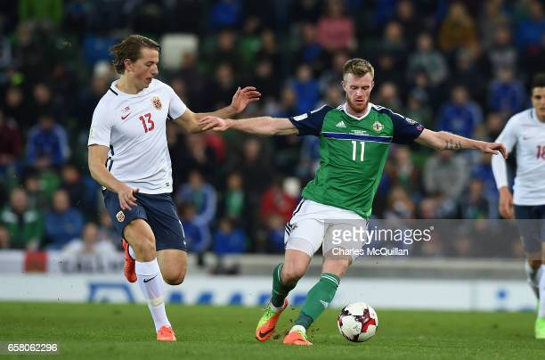 Chris Brunt of Northern Ireland and Sander Berge of Norway during the FIFA 2018 World Cup Qualifier between Northern Ireland and Norway at Windsor...