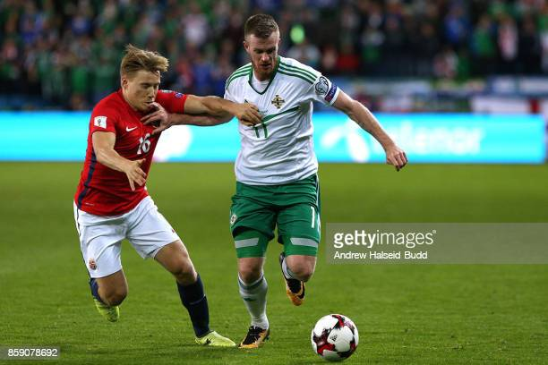 Chris Brunt of Northern Ireland in action against Jonas Svensson of Norway during the FIFA 2018 World Cup Qualifier between Norway and Northern...