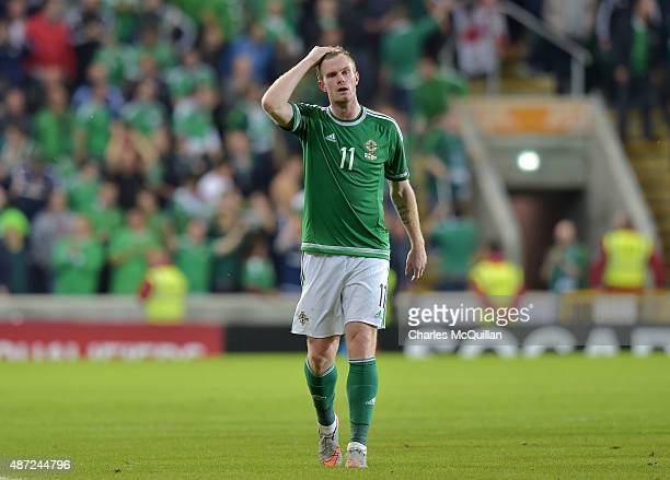 Chris Brunt of Northern Ireland reacts after the Euro 2016 Group F qualifying match between Northern Ireland and Hungary at Windsor Park on September...