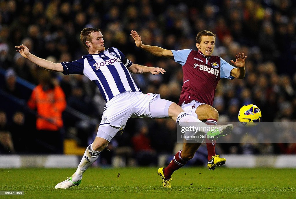 Chris Brunt of West Brom battles with Gary O'Neil of West Ham during the Barclays Premiership match between West Bromwich Albion and West Ham United at The Hawthorns on December 16, 2012 in West Bromwich, England.