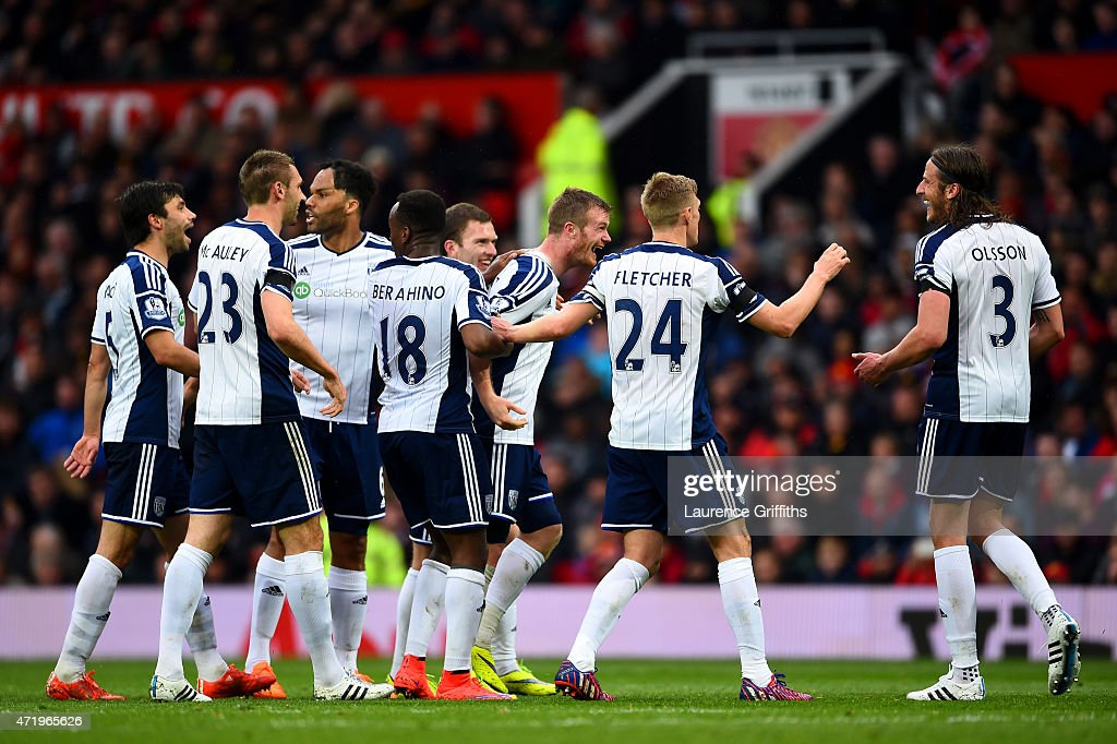 Chris Brunt of West Brom celebrates with teammates after taking a freekick which was deflected off Jonas Olsson of West Brom to score the opening...