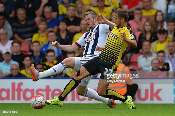 Chris Brunt of West Bromwich Albion and Almen Abdi of Watford compete for the ball during the Barclays Premier League match between Watford and West...