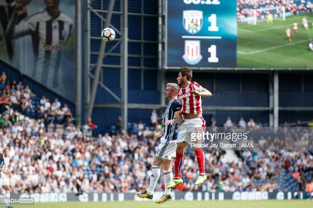 Chris Brunt of West Bromwich Albion and Ramadan Sobhi of Stoke City during the Premier League match between West Bromwich Albion and Stoke City at...