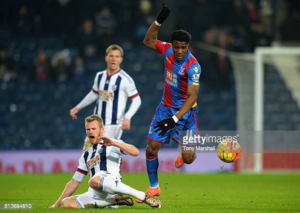 Chris Brunt of West Bromwich Albion competes for the ball against Wilfried Zaha of Crystal Palace resulting in injury during the Barclays Premier...
