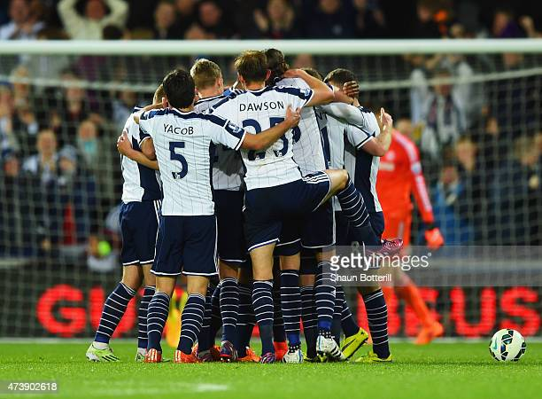 Chris Brunt of West Bromwich Albion is mobbed by team mates in celebration as he scores their third goal during the Barclays Premier League match...