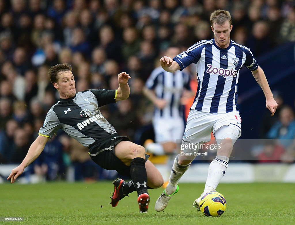 <a gi-track='captionPersonalityLinkClicked' href=/galleries/search?phrase=Chris+Brunt&family=editorial&specificpeople=809047 ng-click='$event.stopPropagation()'>Chris Brunt</a> of West Bromich Albion is tackled by Scott Parker of Tottenham Hotspur during the Barclays Premier League match between West Bromwich Albion and Tottenham Hotspur at The Hawthorns on February 3, 2013 in West Bromwich, England.