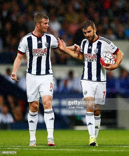 Chris Brunt of West Bromwich Albion talks to James Morrison before his penalty miss during the Barclays Premier League match between West Bromwich...