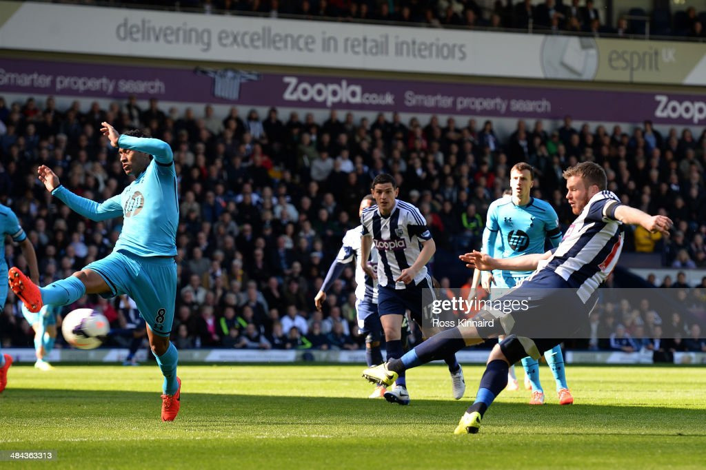 <a gi-track='captionPersonalityLinkClicked' href=/galleries/search?phrase=Chris+Brunt&family=editorial&specificpeople=809047 ng-click='$event.stopPropagation()'>Chris Brunt</a> of West Bromwich scores his team's second goal during the Barclays Premier League match between West Bromwich Albion and Tottenham Hotspur at The Hawthorns on April 12, 2014 in West Bromwich, England.