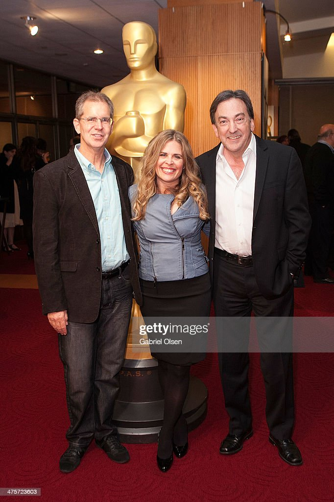 Chris Buck Jennifer Lee and Peter Del Vecho arrive for the 86th Annual Academy Awards Oscar Week Celebration of Animated Features at AMPAS Samuel...