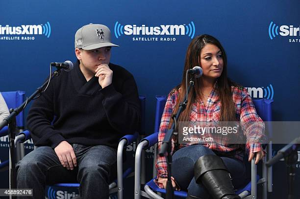 Chris Buckner and television personality Deena Cortese attend Dr Jenn Berman tapes 'The Dr Jenn Show' at SiriusXM Studios on November 11 2014 in New...
