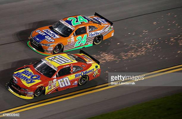 Chris Buescher driver of the BitOHoney Ford leads Eric McClure driver of the Hefty Easy Grip Cups Toyota during the NASCAR XFINITY Series Subway...