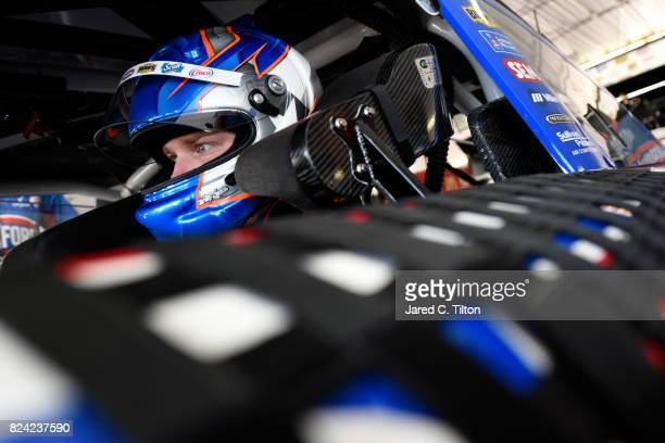 Chris Buescher driver of the Clorox Chevrolet sits in his car during practice for the Monster Energy NASCAR Cup Series Overton's 400 at Pocono...