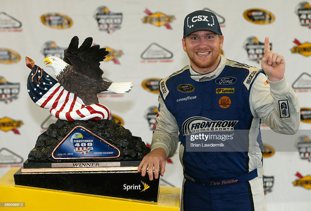 Chris Buescher, driver of the #34 Dockside Logistics Ford, celebrates in victory lane after winning the NASCAR Sprint Cup Series Pennsylvania 400 at Pocono Raceway on August 1, 2016 in Long Pond, Pennsylvania. The race was delayed due to inclement weather on Sunday, July 31.