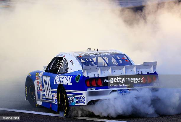 Chris Buescher driver of the Fastenal Ford celebrates winning the series championship with a burnout after the NASCAR XFINITY Series Ford EcoBoost...