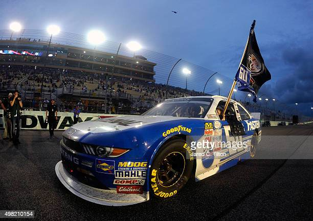 Chris Buescher driver of the Fastenal Ford celebrates winning the series championship after the NASCAR XFINITY Series Ford EcoBoost 300 at...