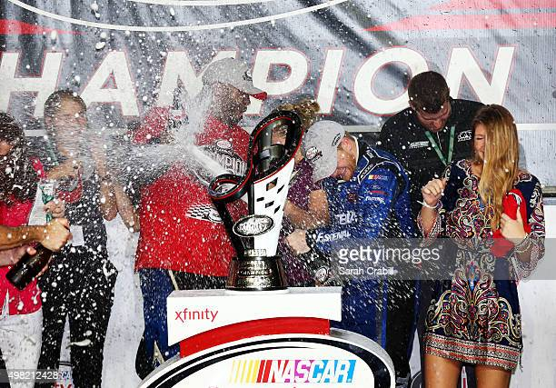 Chris Buescher driver of the Fastenal Ford celebrates winning the series championship with champagne in Victory Lane after the NASCAR XFINITY Series...