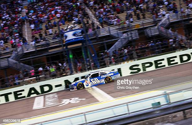 Chris Buescher driver of the Fastenal Ford crosses the finish line to win the series championship during the NASCAR XFINITY Series Ford EcoBoost 300...