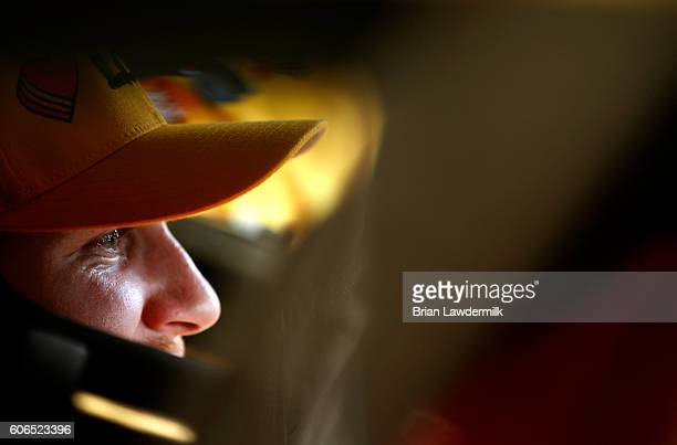 Chris Buescher driver of the Love's Travel Stops Ford sits in his car during practice for the NASCAR Sprint Cup Series Teenage Mutant Ninja Turtles...