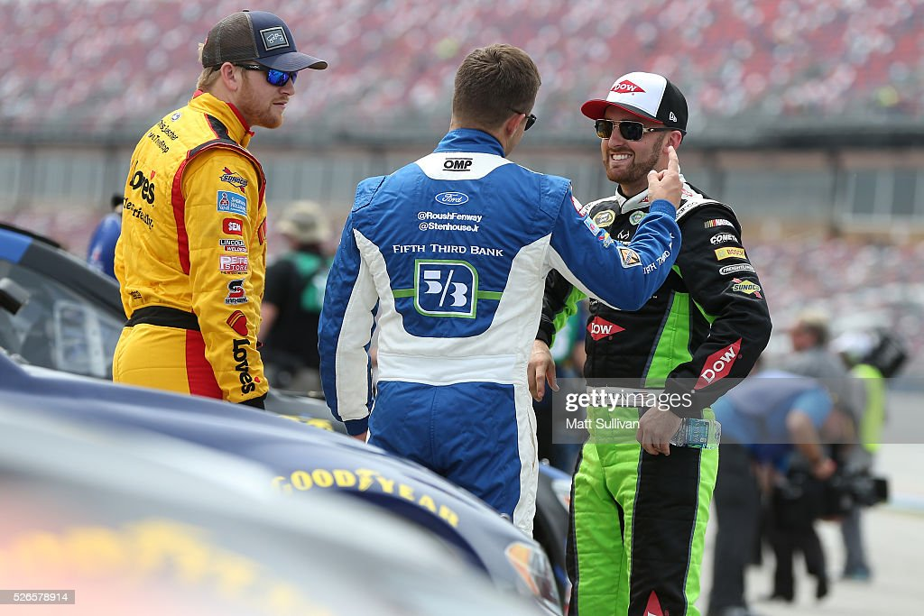 <a gi-track='captionPersonalityLinkClicked' href=/galleries/search?phrase=Chris+Buescher&family=editorial&specificpeople=7728537 ng-click='$event.stopPropagation()'>Chris Buescher</a>, driver of the #34 Love's Travel Stops/CSX-Play it Safe Ford, Ricky Stenhouse Jr, driver of the #17 Fifth Third Bank Ford, and <a gi-track='captionPersonalityLinkClicked' href=/galleries/search?phrase=Austin+Dillon&family=editorial&specificpeople=5075945 ng-click='$event.stopPropagation()'>Austin Dillon</a>, driver of the #3 Dow - Energy & Water/Intellifresh Chevrolet, talk on the grid during qualifying for the NASCAR Sprint Cup Series GEICO 500 at Talladega Superspeedway on April 30, 2016 in Talladega, Alabama.