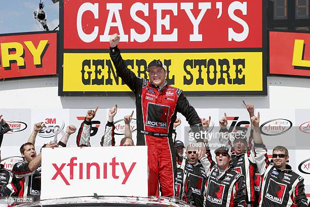 Chris Buescher driver of the Roush Performance Products Ford celebrates in victory lane after winning the NASCAR XFinity Series 3M 250 at Iowa...