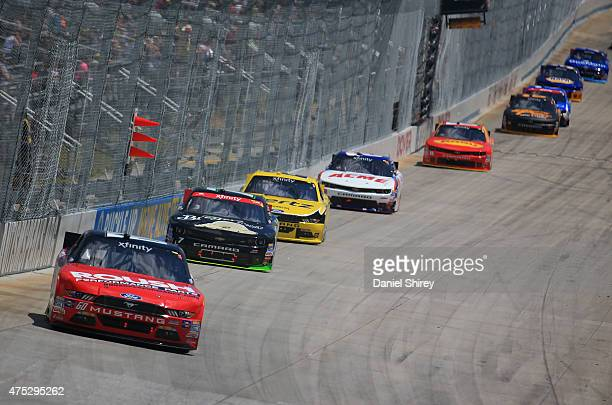 Chris Buescher driver of the Roush Performance Products Ford leads a pack of cars during the NASCAR XFINITY Series Buckle Up 200 presented by Click...