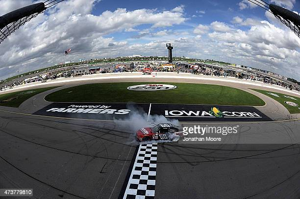 Chris Buescher driver of the Roush Performance Products Ford Mustang Ford celebrates after taking the checkered flag in the NASCAR XFinity Series 3M...