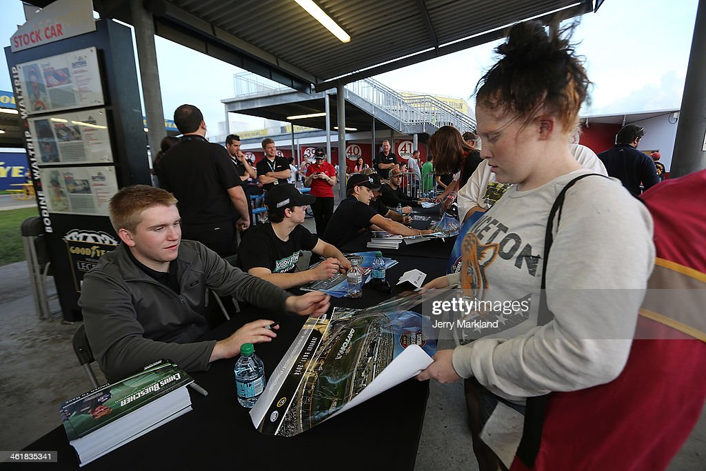 Chris Buescher signs autographs at the NASCAR Nationwide Series Preseason Thunder at Daytona International Speedway on January 11, 2014 in Daytona Beach, Florida.