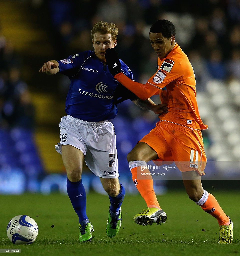 Chris Burke of Birmingham and Thomas Ince of Blackpool chalenge for the ball during the npower Championship match between Birmingham City and Blackpool at St Andrews on March 5, 2013 in Birmingham, England.