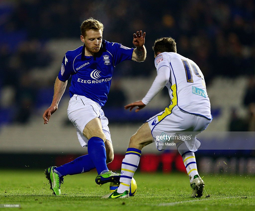 Chris Burke of Birmingham City is tackled by Aidy White of Leeds United during the FA Cup with Budweiser Third Round Replay match between Birmingham City and Leeds United at St Andrews on January 15, 2013 in Birmingham, England.
