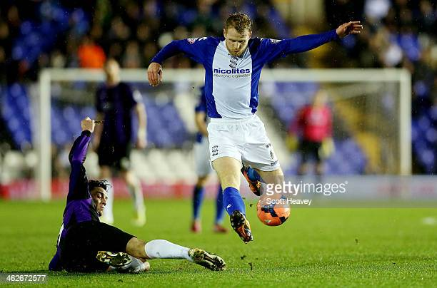 Chris Burke of Birmingham in action with Lee Brown of Bristol Rovers during the FA Cup Third Round match between Birmingham City and Bristol Rovers...