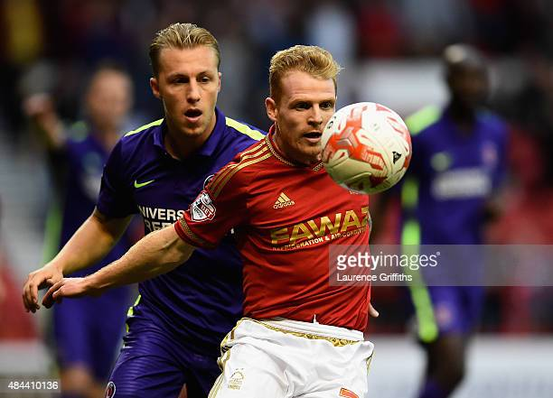Chris Burke of Nottingam Forest battles with Chris Solly of Charlton Athletic during the Sky Bet Championship match between Nottingham Forest and...