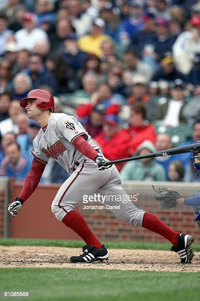 Chris Burke of the Arizona Diamondbacks connects with a pitch during the game against the Chicago Cubs on May 9 2008 at Wrigley Field in Chicago...