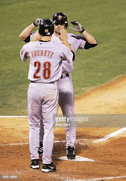 Chris Burke of the Houston Astros is congratulated by Adam Everett after Burke hit a pinchhit tworun home run in the seventh inning against the St...