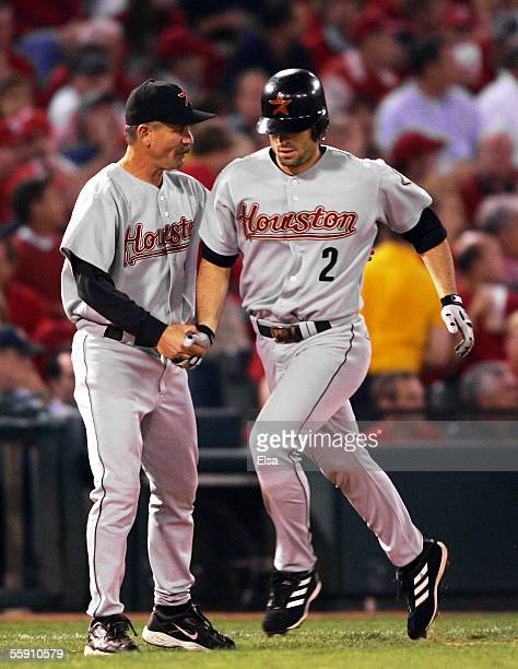 Chris Burke of the Houston Astros is congratulated by thirdbase coach Doug Mansolino after hitting a pinchhit tworun home run in the seventh inning...