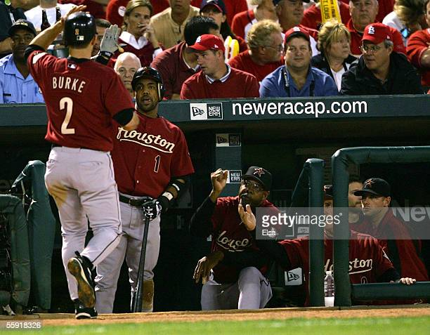 Chris Burke of the Houston Astros is congratulated by Willy Taveras after scoring on a wild pitch in the second inning against the St Louis Cardinals...
