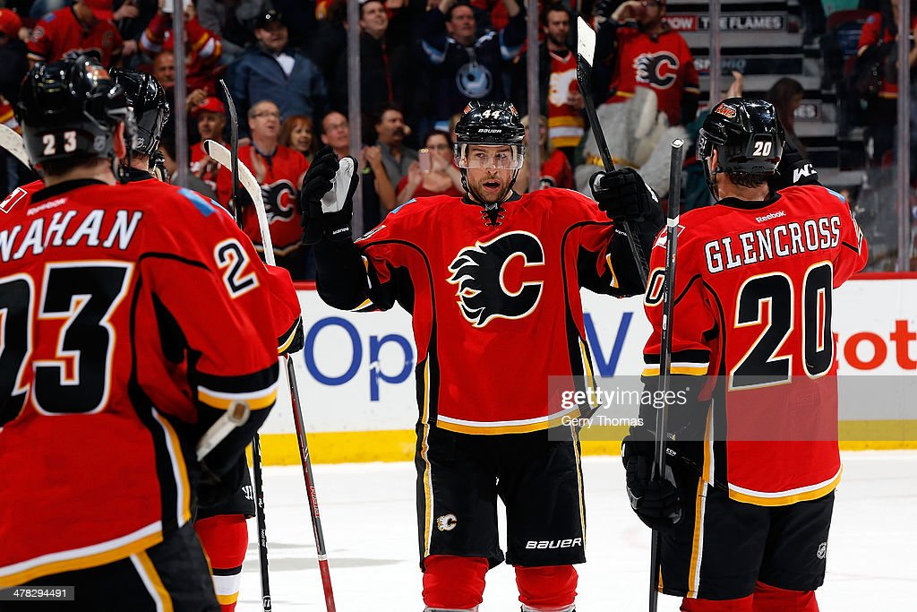 Chris Butler #44, <a gi-track='captionPersonalityLinkClicked' href=/galleries/search?phrase=Curtis+Glencross&family=editorial&specificpeople=2190970 ng-click='$event.stopPropagation()'>Curtis Glencross</a> #20 and teammates of the Calgary Flames celebrate a 7-2 win against the Anaheim Ducks at Scotiabank Saddledome on March 12, 2014 in Calgary, Alberta, Canada.