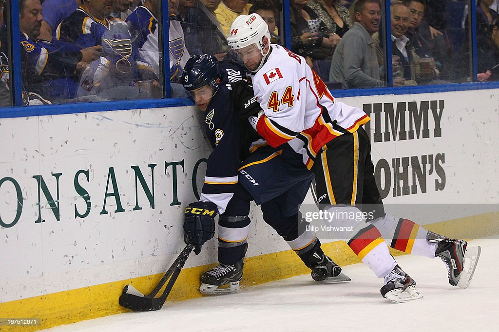 Chris Butler #44 of the Calgary Flames and <a gi-track='captionPersonalityLinkClicked' href=/galleries/search?phrase=Jaden+Schwartz&family=editorial&specificpeople=7029354 ng-click='$event.stopPropagation()'>Jaden Schwartz</a> #9 of the St. Louis Blues fight for control of the puck during the third period at the Scottrade Center on April 25, 2013 in St. Louis, Missouri. The Blues beat the Flames 4-1.