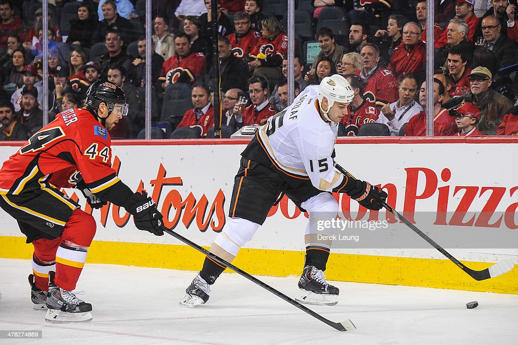 Chris Butler #44 of the Calgary Flames chases Ryan Getzlaf #15 of the Anaheim Ducks during an NHL game at Scotiabank Saddledome on March 12, 2014 in Calgary, Alberta, Canada.