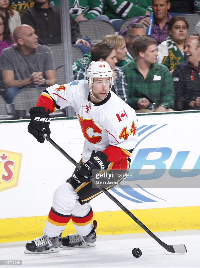 Chris Butler #44 of the Calgary Flames handles the puck against the Dallas Stars at the American Airlines Center on March 14, 2014 in Dallas, Texas.