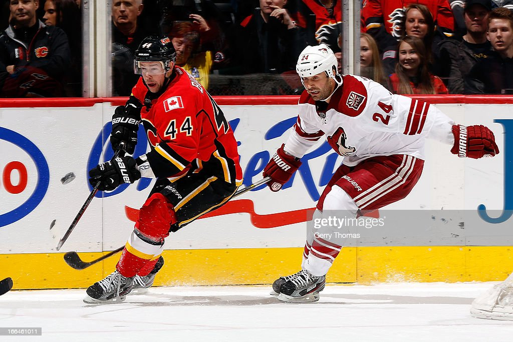 Chris Butler #44 of the Calgary Flames skates against <a gi-track='captionPersonalityLinkClicked' href=/galleries/search?phrase=Kyle+Chipchura&family=editorial&specificpeople=879784 ng-click='$event.stopPropagation()'>Kyle Chipchura</a> #24 of the Phoenix Coyotes on April 12, 2013 at the Scotiabank Saddledome in Calgary, Alberta, Canada.