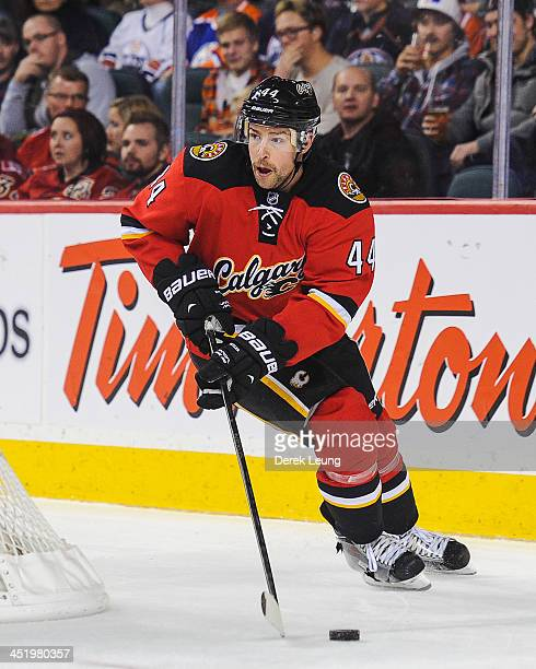 Chris Butler of the Calgary Flames skates against the Edmonton Oilers during an NHL game at Scotiabank Saddledome on November 16 2013 in Calgary...