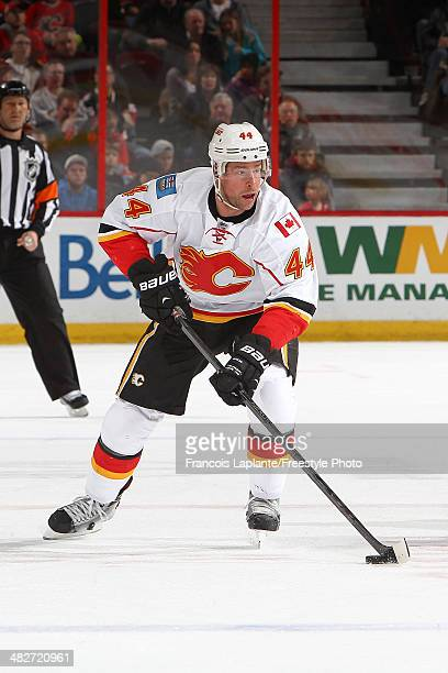 Chris Butler of the Calgary Flames skates with the puck against the Ottawa Senators at Canadian Tire Centre on March 30 2014 in Ottawa Ontario Canada