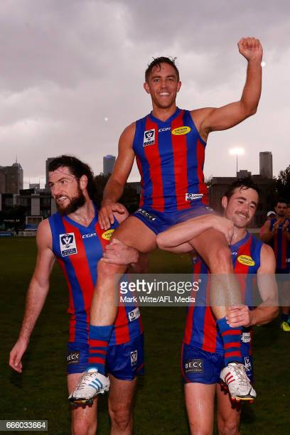 Chris Cain of Port Melbourne Borough celebrates 175 games and a life membership for Port Melbourne Borough during the round one VFL match between...