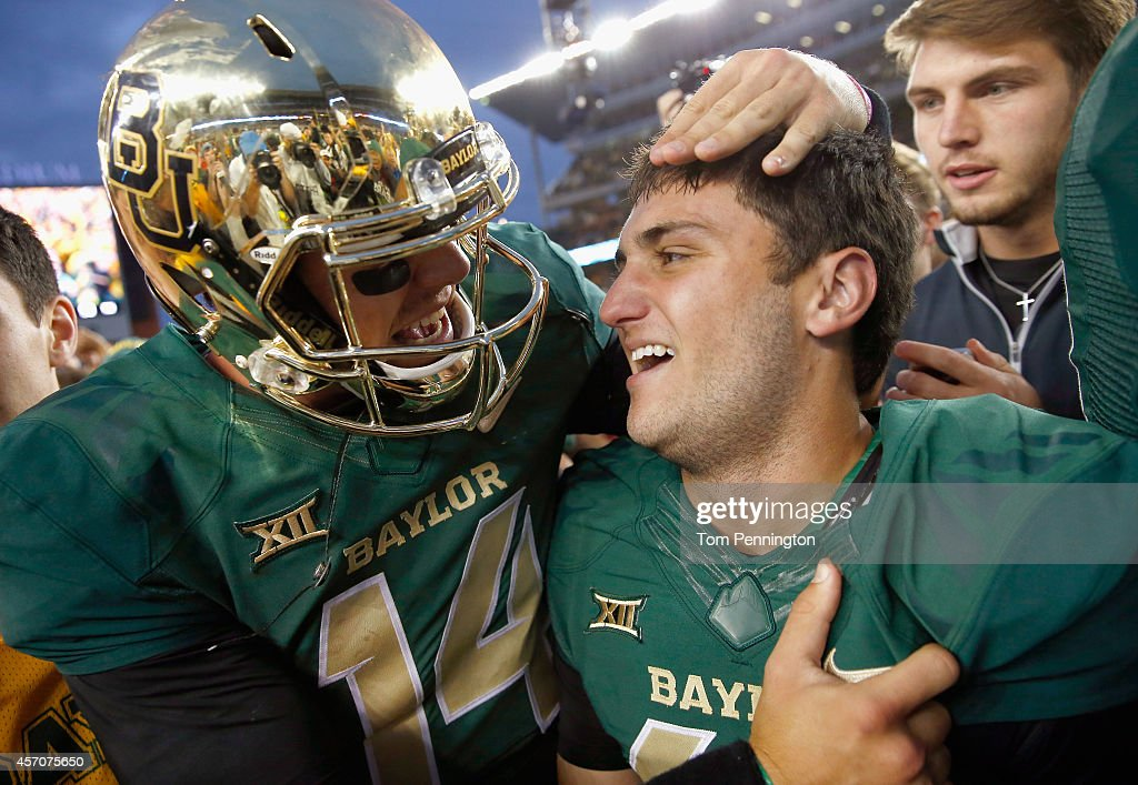 Chris Callahan of the Baylor Bears celebrates with Bryce Petty of the Baylor Bears after kicking the game winning field goal against the TCU Horned...