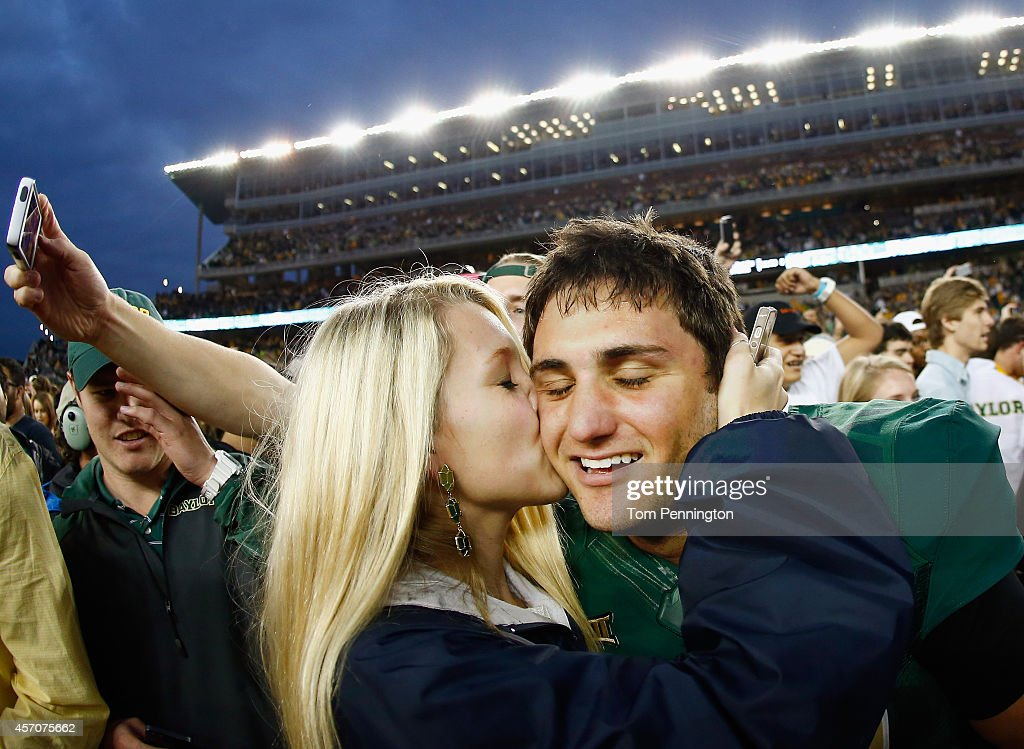 Chris Callahan of the Baylor Bears celebrates with Grace Dille after kicking the game winning field goal against the TCU Horned Frogs to win 6158 at...