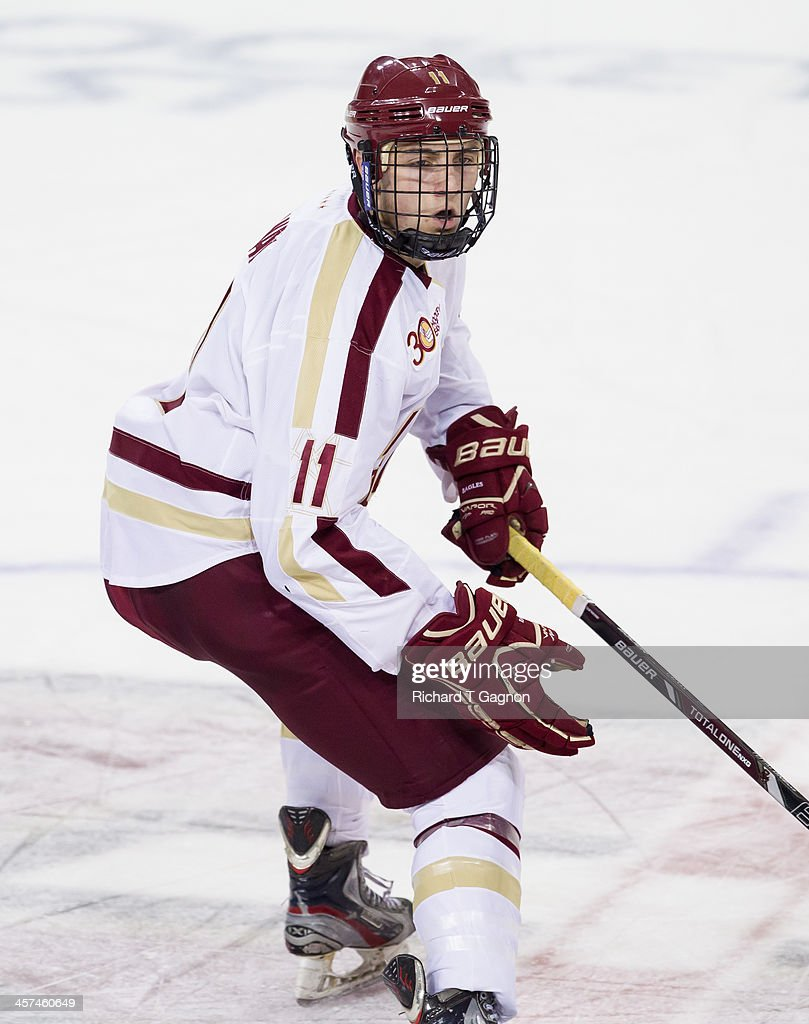 Chris Calnan #11 of the Boston College Eagles skates across center ice during NCAA hockey action against the New Hampshire Wildcats at Kelley Rink on December 6, 2013 in Chestnut Hill, Massachusetts.