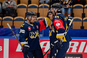 Chris Campoli of HV71 celebrate with Teemu Laine of HV71and Ryan O'Byrne of HV71 after scoring during the Champions Hockey League group stage game...
